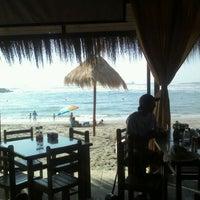 Photo taken at Tuto Beach by Natalia H. on 11/28/2011