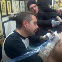 Photo taken at Sid's Tattoo Parlor by Matthew Y. on 11/2/2011