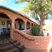 Photo taken at Ojo Caliente Mineral Springs Resort & Spa by Matt B. on 7/21/2012