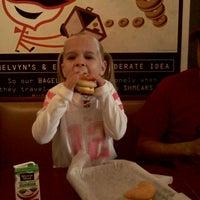 Photo taken at Einstein Bros Bagels by Sandee C. on 12/11/2011