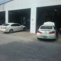 Photo taken at Mad Hatter Tire and Auto Center by Chris L. on 8/3/2012