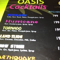 Photo taken at Oasis Bar and Grill by Mel F. on 7/6/2012