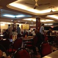 Photo taken at Restoran Lotus (Restaurant) by SK S. on 9/4/2012