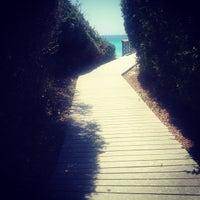 Photo taken at Blue Mountain Beach by Joanna S. on 5/20/2012