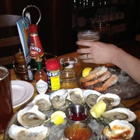 Photo taken at Hank's Oyster Bar by Jennifer C. on 3/24/2012