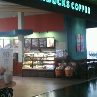 Photo taken at Starbucks Coffee by noxbil o. on 7/23/2012