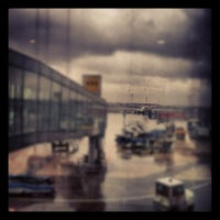 Photo taken at Gate 111 by BelcE Y. on 3/12/2012