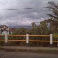Photo taken at Cigombong by Sari S. on 3/9/2012