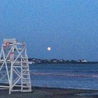 Photo taken at Easton's Beach by Sarah M. on 8/3/2012