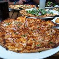 Photo taken at California Pizza Kitchen by Gilberto V. on 5/12/2012