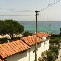 Photo taken at Spiaggia Seccheto by Moniek F. on 7/1/2012