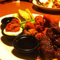 Photo taken at TGI Fridays by Leah T. on 4/17/2012