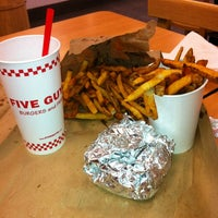 Photo taken at Five Guys by Ana Carolina V. on 3/4/2012