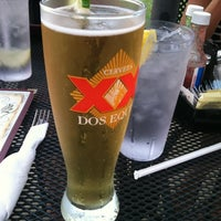 Photo taken at Louie's Grill Fusion Restaurant by Jeff H. on 5/27/2012