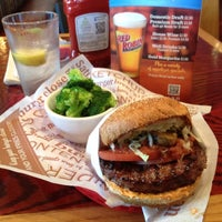 Photo taken at Red Robin Gourmet Burgers by Daniel M. on 5/18/2012
