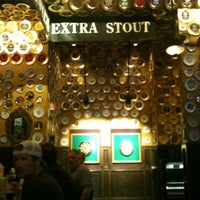 Photo taken at Flying Saucer Draught Emporium by Leslie C. on 9/3/2012