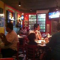 Photo taken at Juan Pan Pizza by Nayda P. on 7/27/2012
