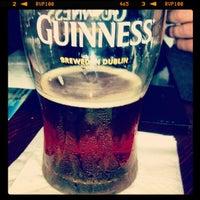 Photo taken at Madra Rua Irish Pub by Ray B. on 7/27/2012