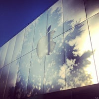 Photo taken at Apple University Village by Carl T. on 7/10/2012