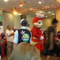 Photo taken at Jollibee / Greenwich Pizza by Harrie S. on 7/1/2012