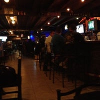 Photo taken at Mac's American Bar and Grill by Roberto C. on 2/25/2012
