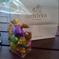 Photo taken at Godiva Chocolatier by Robert M. on 5/27/2012