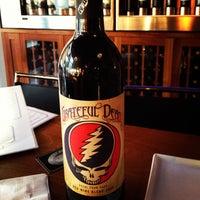 Photo taken at TAPS Bar & Lounge by Tess C. on 6/4/2012