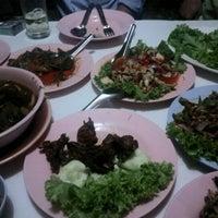 Photo taken at Thai/Lao Restaurant by Manassanunt D. on 11/10/2011