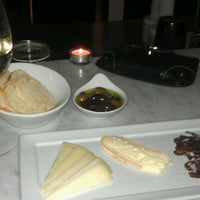 Photo taken at Cellar Wine Bar by Amanda H. on 1/12/2012