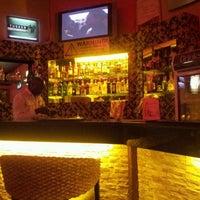 Photo taken at Sherlock's Bistro, Den & Lounge by Gerald O. on 6/1/2012