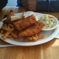 Photo taken at Blue Lobster Grille by Lorenzo G. on 10/16/2011