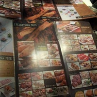 Photo taken at Zakkushi Charcoal Grill by Lily T. on 12/13/2011