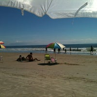Photo taken at Praia de Itapema do Norte by Bruna S. on 1/19/2012