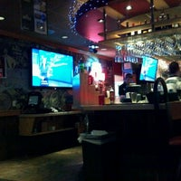 Photo taken at Applebee's Neighborhood Grill & Bar by Chris A. on 12/19/2011