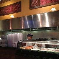 Photo taken at Hot Woks Cool Sushi by Devin B. on 7/29/2012