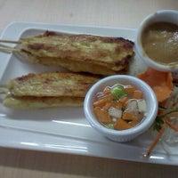 Photo taken at Thai Time Cafe by Kayla M. on 10/5/2011