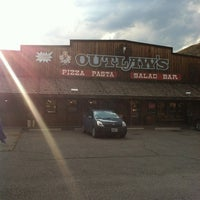 Photo taken at Outlaws Pizza by Jordan C. on 7/29/2012