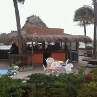 Photo taken at Outrigger Beach Hotel & Resort by Ryan T. on 10/21/2011