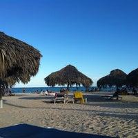 Photo taken at Playa Los Corales by Mariana B. on 1/8/2012