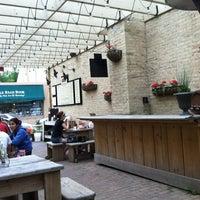Photo taken at Bartolotta's Pizzeria Piccola by Liesel O. on 5/25/2012