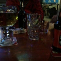 Photo taken at Cujo's Sports Bar and Grill by Linsey S. on 1/6/2012