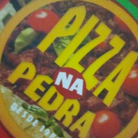 Photo taken at Pizza na Pedra by Renata M. on 10/16/2011