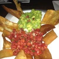 Photo taken at Mezon Tapas Bar & Restaurant by Cindy F. on 7/8/2012