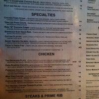 Photo taken at Charleston's Restaurant by Aaron K. on 8/21/2011