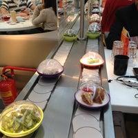 Photo taken at YO! Sushi by Malaika M. on 4/12/2012