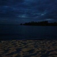 Photo taken at Pantai Saujana (Pantai Batu Empat) by choiyee s. on 12/23/2011