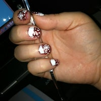 Photo taken at Nails By Gina by Gina V. on 12/28/2011
