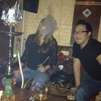 Foto diambil di Cozy Cafe Hookah Lounge oleh Megan J. pada 1/13/2012
