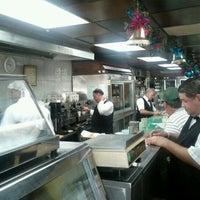 Photo taken at El Hipopotamo Restaurant & Delicatessen by Ezequiel R. on 1/6/2012