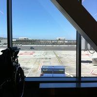 Photo taken at Gate 58B by John T. on 7/3/2012
